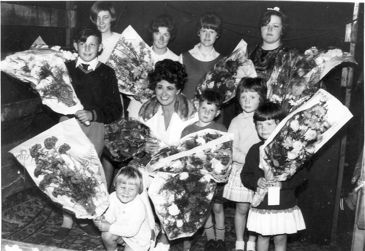 Elsie Tanner with flowers